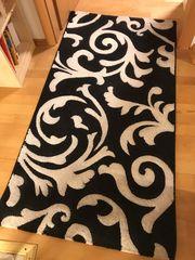 Teppiche 2x schwarz mit weißen