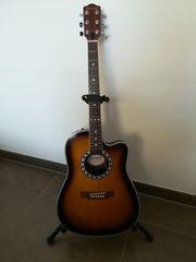 Gitarre mit eingebautem Tonabnehmer und