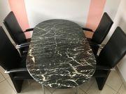 Marmor Esstisch mit Lederstühlen schwarz