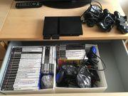 Neuwertige PlayStation 2 mit Zubehör