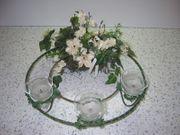 Blumengesteck mit Teelichter